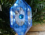Vintage Jewel Brite Blue Hard Plastic Christmas Ornament With A Poinsettia