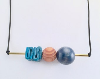 Blue Swirl Polymer Clay Bead Wood Bead Brass Tube Corded Necklace