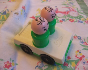 fisher price car with two riders