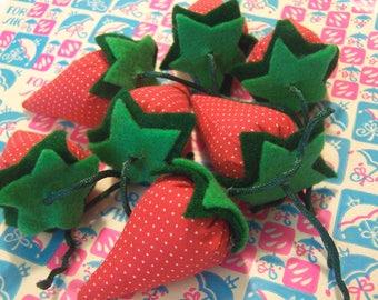 seven stuffed fabric and felt strawberries