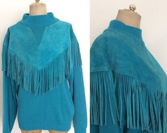30% OFF 1980's Turquoise Acrylic Knit Sweater w/ Leather Fringe Bib Pullover Vintage Sweater by Maeberry Vintage