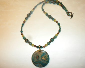 Round Green And Gold Choi Finches Necklace
