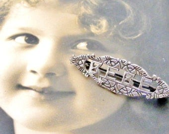 French art deco silver plated Bebe brooch