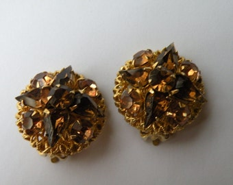 20% off Topaz rhinestone filigree clip-on earrings. Gold plated. Patent pending.