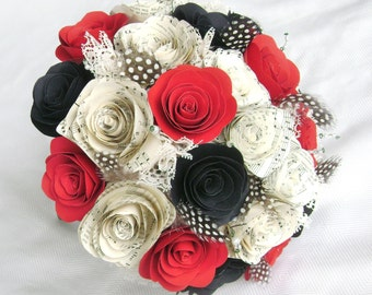 Wedding bouquet with red black and sheet music spiral roses cabbage paper flowers with feathers and lace alternative
