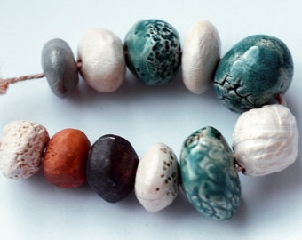 RESERVED for M.B. Immensity of the sea -- 11 metallic, turquoise, antique looking, pearly white ceramic art beads