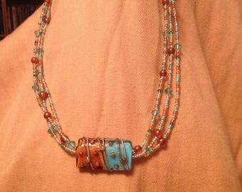 Statement necklace with lampworked focal bead and sterling clasp