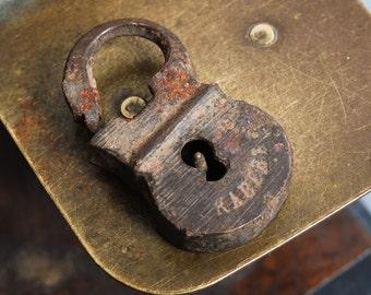Antique small miniature brass padlock, original dark patina.