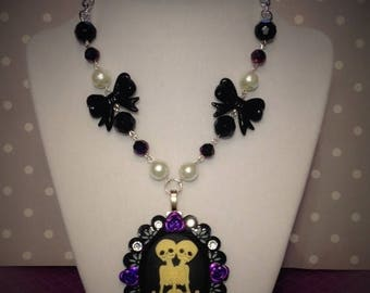 CLEARANCE Conjoined twins cameo necklace, twin skeletons, goth and rockabilly, crystals, roses and black bows