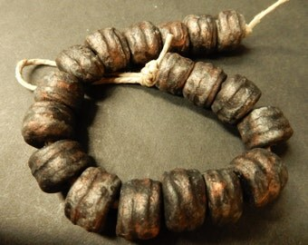 18 Large hand made short tube….embossed … white stoneware clay beads with a dirty black, copper patina… #3393