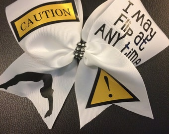 "Cheer Bow- ""CAUTION May Flip"" with Rhinestone center"