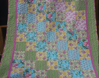 Full to Queen pieced with, beautiful free spirit fabrics bright cheerful flowers and designs