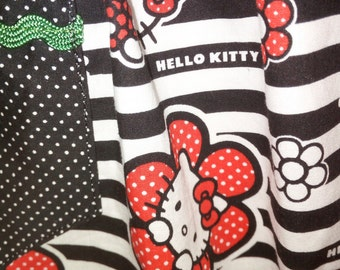 Child's apron size 7 - 8 yrs. with 'Hello Kitty' skirt, waistband & ties