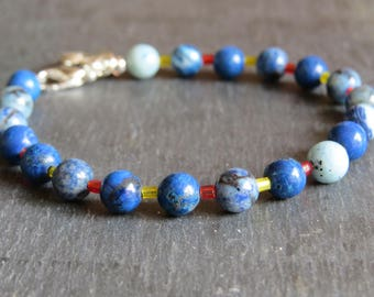mottled blue beads with red and yellow glass spacer bead bracelet