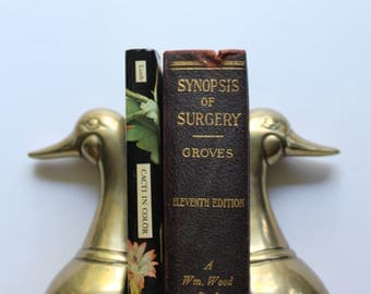 Vintage Set of Solid Brass Duck Head Bookends