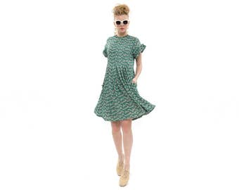 The grass is Green and the dress is pretty, Green dress with flowers print, Short Dress with Pleats, Trendy Stella and Lori Handmade Dress