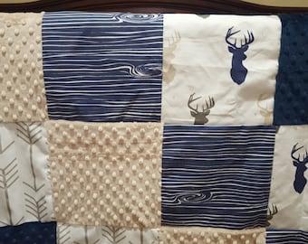 Buck Patchwork Blanket-mixed tan navy buck, navy woodgrain, white tan arrow, navy minky, and tan minky Patchwork Baby Blanket