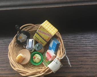 Basket of 1950's dollhouse goodies