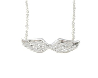 ANGEL wing necklace.  Charm comes on Heaven Sent  card.  Perfect gift for adorable girls.
