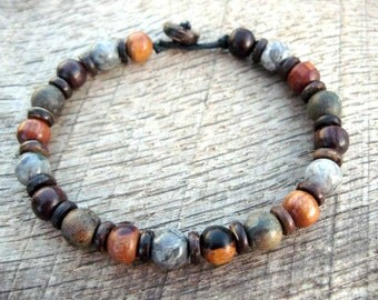 Mens bracelet, grey jasper and mixed wood beads, tribal surfer style, earthy natural materials, strong cord, toggle, loop clasp, handmade