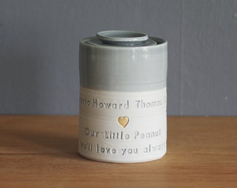 custom baby urn, infant urn. gold infilled stamp, lid and quote, straight shaped urn with custom stamp. modern simple urn for ashes.