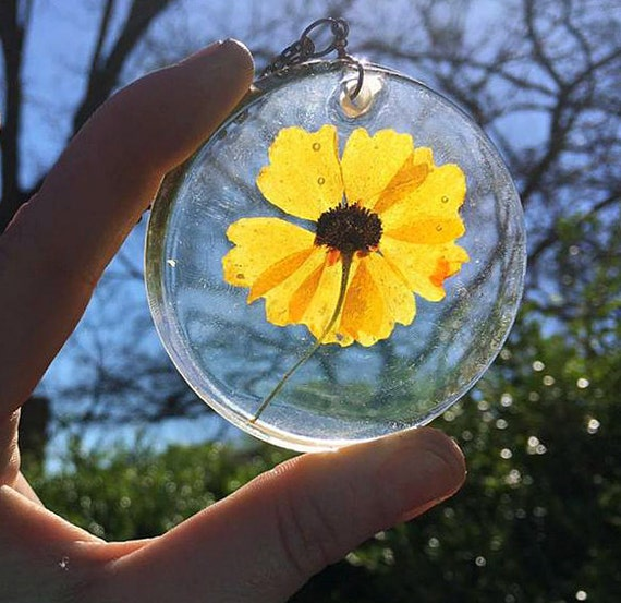 Genuine Yellow Botanical Specimen Preserved in Clear Casting Resin, enclosed within a Large Round Pendant, Antiqued Bronze Necklace Chain.