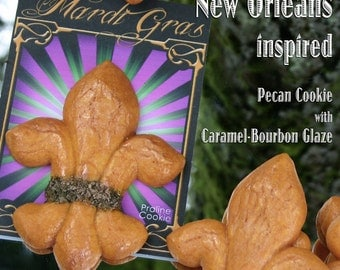 "Delivered Mardi Gras cookies; Two Praline ""Fleur de Lis"" Pecan Cookies w/ Caramel Bourbon Glaze individually packaged in Purple Green & Gold"