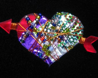Artisan HEART Brooch has Red Lucite Foundation, Purple, Green & Silver Foil Overlaid with Colorful Seed Beads on Copper Wire.  Signed BN
