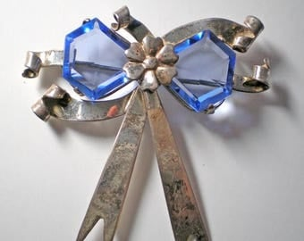 15% DISCOUNT Vintage Faceted Blue Glass and Sterling Bow Brooch     Item No: 16288