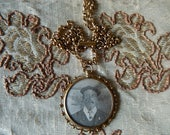 Victorian double photograph locket necklace and gold tone metal chain wearable pendant circa 1890