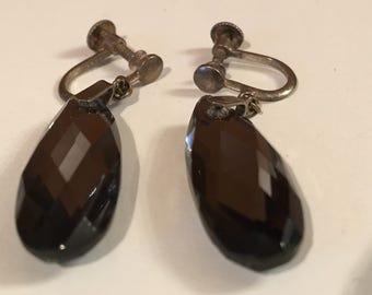 Smokey Crystal screw on earrings.