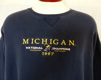 Go UMich Wolverines vintage 90's University of Michigan navy blue fleece graphic sweatshirt ncaa 1997 national champions embroidered logo XL