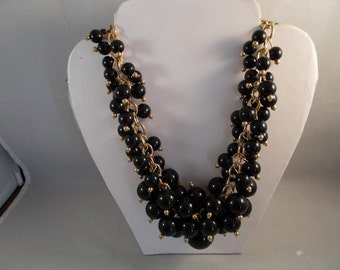 Bib Necklace with Black Bead Pendants on a Gold Tone Chain