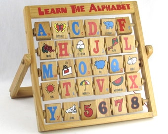 Old Fashioned Alphabet Blocks On Wood Stand - Double Sided Spinning Blocks with Pictures and Letters and Numbers One (1) to Eight  (8)