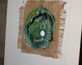 Green felted seed pod