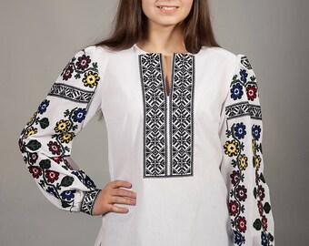 Women white vyshyvanka. Traditional Ukrainian women's blouse. Ethnic sorochka shirt. Ukrainian clothes. Embroidered blouse cross-stitch