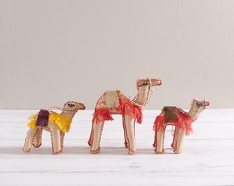 Set of Three Vintage Leather Camels