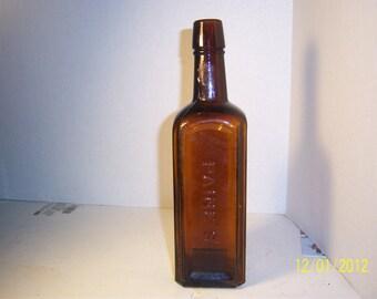 1890's Paine's Celery Compound Burlington, Vt  9 5/8 inch amber medicne bottle No 1