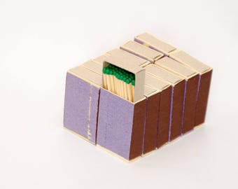 Twelve matchboxes, wooden matches with emerald green tips inside, striker from two sides, hanpacked item