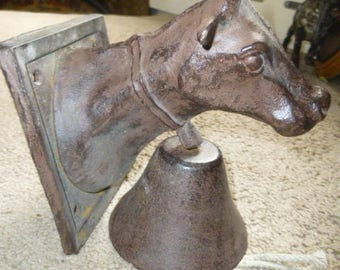 Wall Mounted Cow with Bell - Cowbell - Dinner or Doorbell -Indoors or Out - Rugged Cast Iron Cows Head Mounts to wall with Hanging Bell