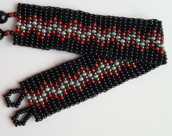 Black, red and silver beadweaving bracelet