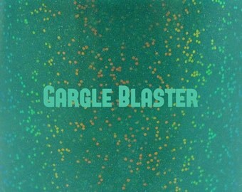 "Gargle Blaster glitter glow-in-the-dark nail polish 15 mL (.5 oz) from the ""Don't Panic"" Collection"