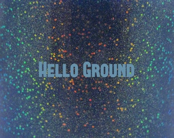 "Hello Ground glitter glow-in-the-dark nail polish 15 mL (.5 oz) from the ""Don't Panic"" Collection"