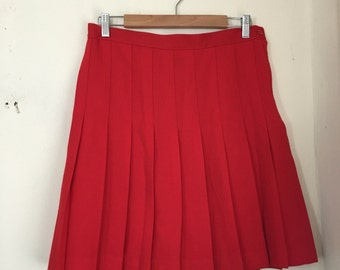 Cherry red pleated mini skirt