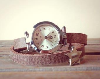 Wristwatch with beaded star