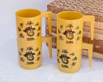 Set of four yellow/orange Australian swagman plastic picnic cups - Aussie bush - Australia - stackable - yellow - barbeque