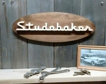 1950's Studebaker Emblem Oval Wall Plaque-Unique scroll saw automotive art created from wood for your garage, shop or man cave.