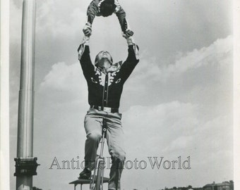 Circus unicycle performer with chimpanzee animal trainer vintage photo