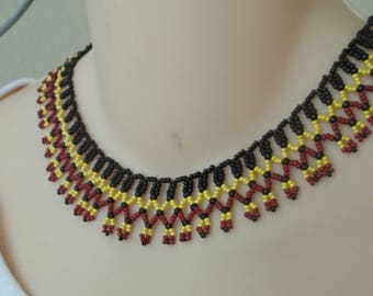 Black, red and yellow bib necklace