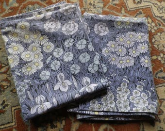A Pair of Vintage 1970's Pillowcases in Pat Albeck Design Blue Irises Daisies and Leaves